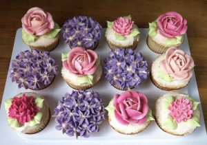 Cupcakes with buttercream roses and hydrangeas